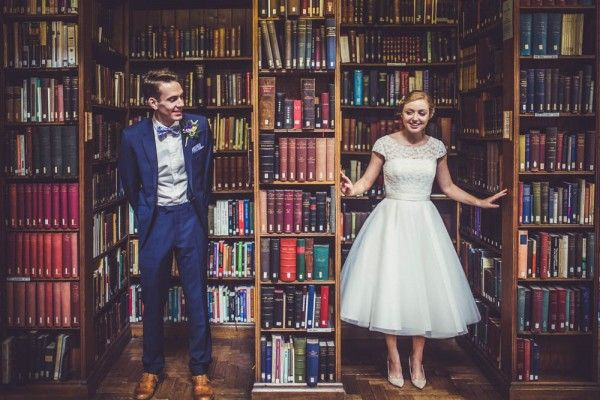 The perfect wedding portrait for book lovers | Image by Claire Penn Photography