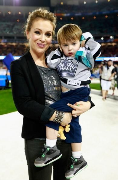 Alyssa Milano & her son at a sporting event...nice picture! 8.15