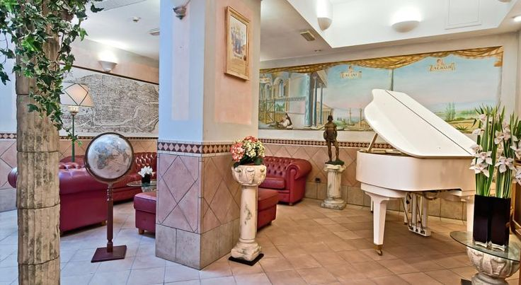 Hotel Alimandi Via Tunisi Roma This family-run hotel is located opposite the Vatican Museums and the entrance to the Sistine Chapel. The sun terrace offers views of St. Peter's Basilica.