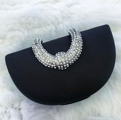 Black jewelled clutch.