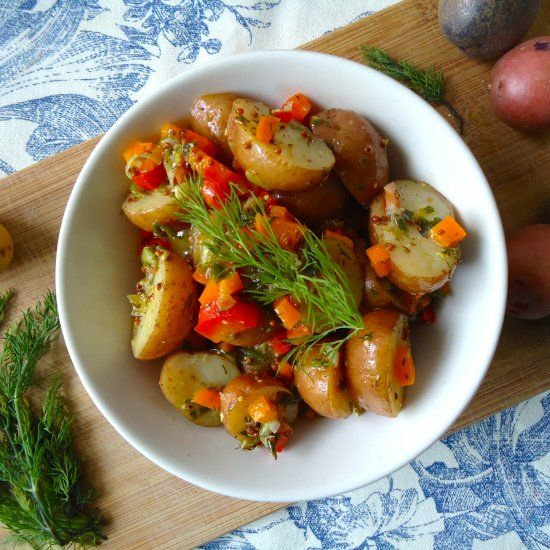 Warm, tangy & light potato salad that takes no more than 15 minutes to make.