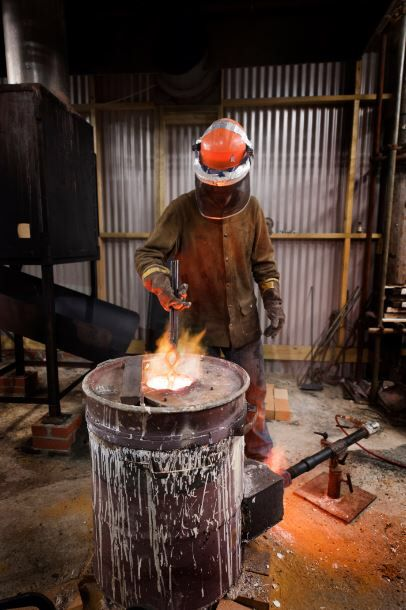 Vincent recharging the furnace at London Bronze Casting Ltd