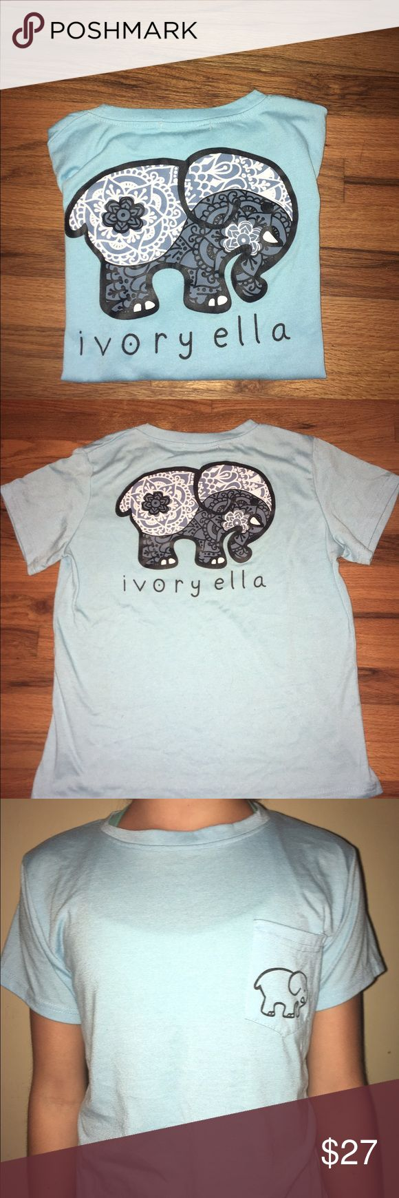 Ivory Ella t shirt Beautiful minty blue shirt by ivory Ella. Black and white Yin yang design inside the elephant on back. Size large but I am a women's small and it fits well, on the looser side. I am honestly not sure if this is authentic or not, because the tag does not say ivory Ella. Either way, it has all the classic ivory Ella features down to the fabric and fit. Feel free to comment any questions, or offer ivory ella Tops Tees - Short Sleeve