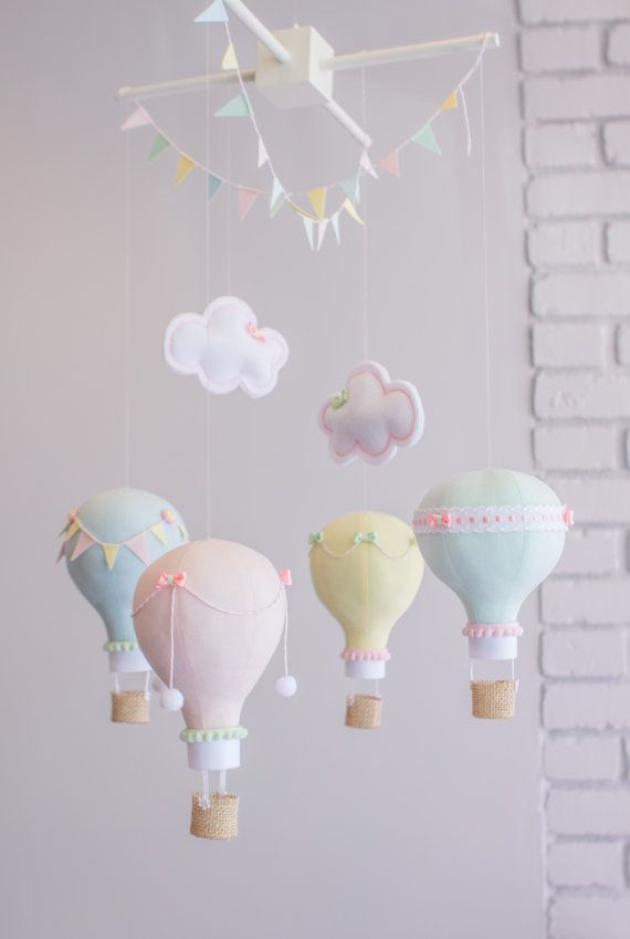 This is a made to order baby mobile in pastels with pops of bolder pastels. Mint, Aqua, Pink, Yellow and Blush. The photos show 5 hot air