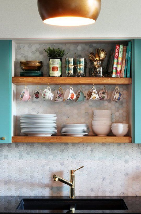 Before & After: A Modern Vintage Loft Kitchen Makeover.  Totally want to copy these shelves in my studio!