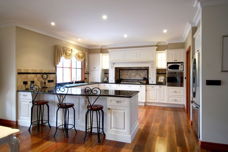 Country style kitchen with natural granite bench tops