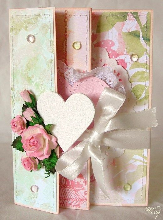 beautiful - score and fold at 4, 10 and 16 cm.  decorate each panel with different paper. cut slit in from panel and slide ribbon through it and tie in front. Paper 15x27 cm