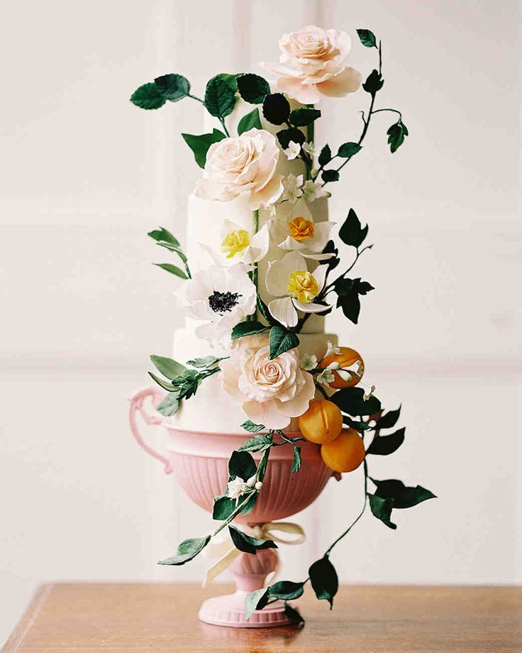 Spring Wedding Ideas from Real Celebrations | Martha Stewart Weddings - This vine-covered three-tier wedding cake was decorated with sugar roses, anemones, and peaches. #weddingcakes #springwedding