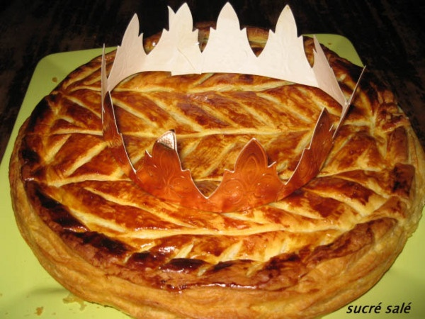 "galette des rois.  Whoever finds the ""fève"" gets the crown.  The fève is a small ceramic object hidden in the pastry.  The best pastries have an almond-powder filling.  These pastries are only available after Christmas - early January."