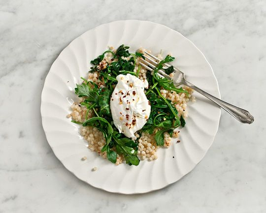Poached egg over greens and toasted couscous