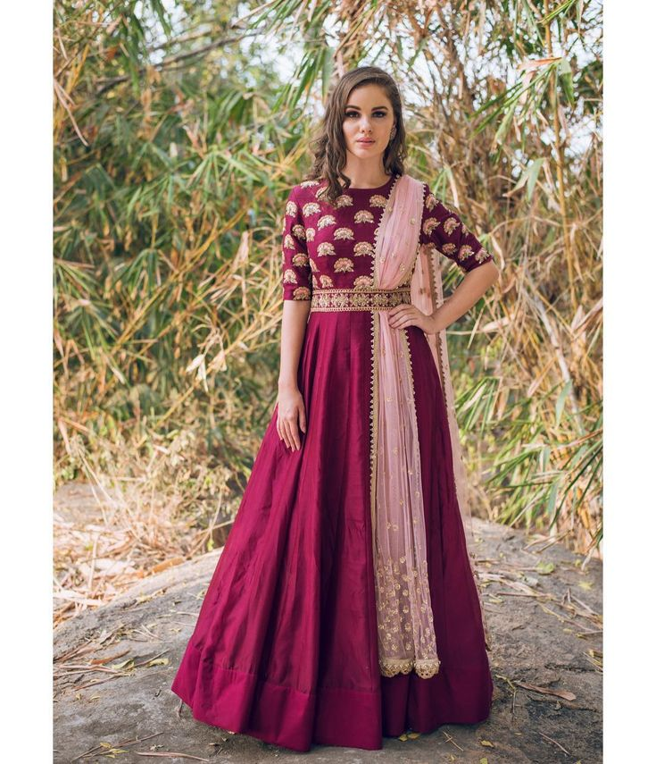 BEautiful wine color floor length anarkali dress with blush pink color net dupatta. Anarkali dress with hand embroidery work on yoke.  Meenakshi collection of Mrunalini Rao  .Photography by Akshay Rao. 28 December 2017