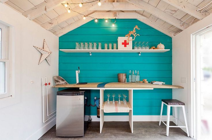 Surfboard bar in the small beach style shed captures the magic of lazy summer days - Decoist