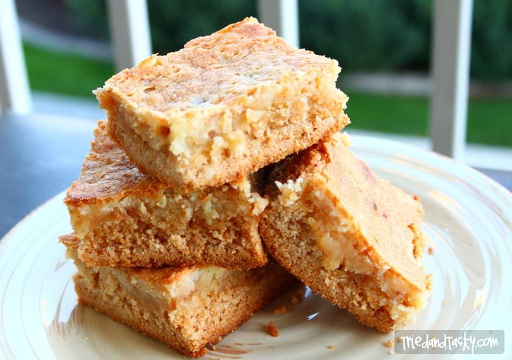 When the recipe is from Paula Deen you know it's going to be good. This Toffee Gooey Butter Cake is a rich cake will put a smile on your face (with toffee!)