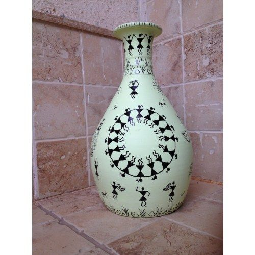 Warli art on a Terra cotta flower vase. Ideal to keep dry floral arrangement or use it as a decorative item.