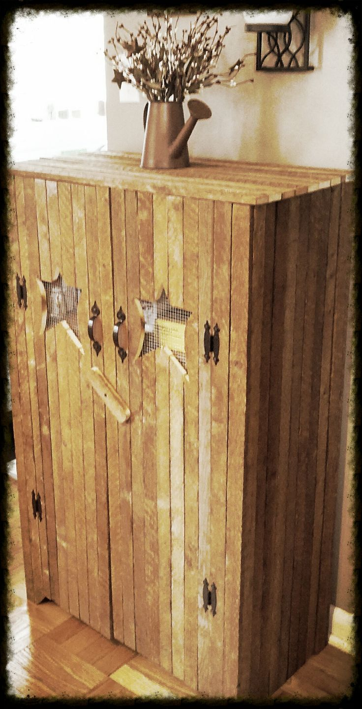Bought this cabinet from a vendor in St. Jacob's.  It's made from recycled tobacco sticks.  We use it as a pantry.  Absolutely love it!