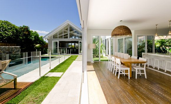 This stunning design by BGD Architects draws inspiration from the classic style of the Sydney beach house. The high vaulted timber ceilings and crisp white finishes are reminiscent of this style.