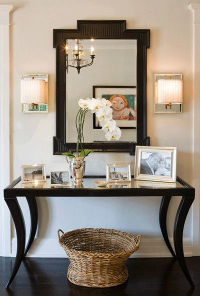Mirror mirror on the wall accessorize above the console Foyer console decorating ideas