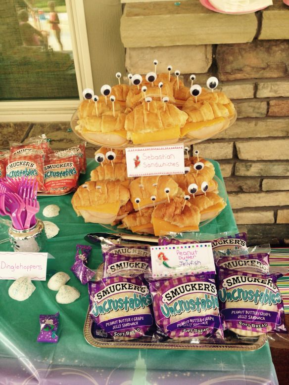 The Little Mermaid themed Birthday Party Food. Sebastian sandwhiches and Peanut butter and jellyfish Sandwhiches