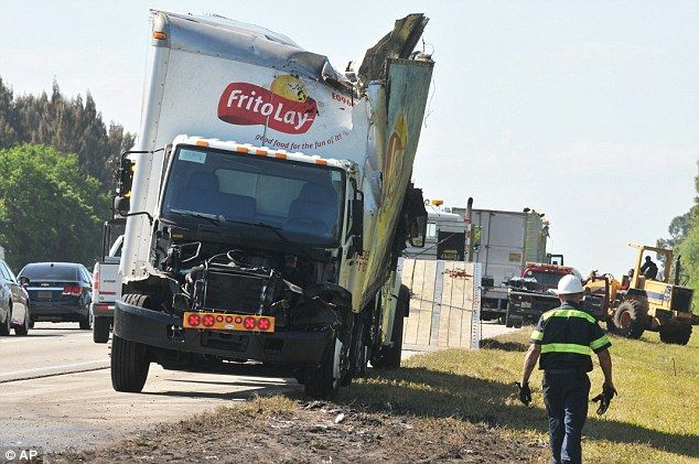 A truck hauling Frito Lay chips is damaged after colliding with a truck carrying Busch beer on southbound 1-95 near Melbourne, Florida, on Wednesday, March 23, 2016