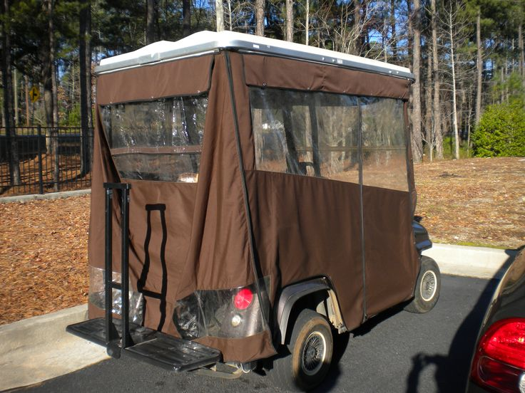 This solid color golf cart enclosure has a back panel with clear plastic for the back seat riders and clear plastic around the rear lights so their visible when driving the cart at night.