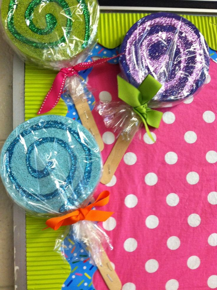 The Short and Sassy Teacher: How amazing is this Sweet Shoppe theme? Those lollipops look divinely easy to make for your classroom! #glitter