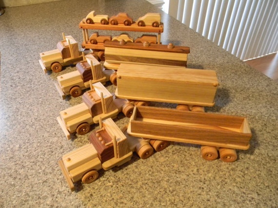 Wooden Toy Trucks. Link leads nowhere but these would be easy to figure out and build.