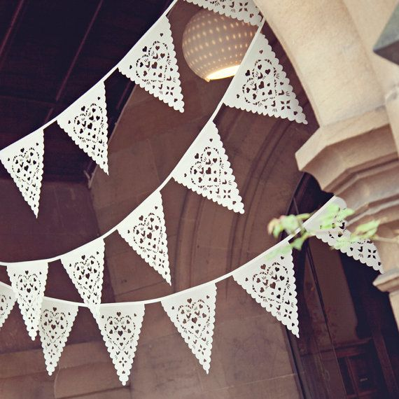 A beautiful fabric bunting for your wedding decoration, They can be used outside, but bring them in after your event, they prefer to stay inside!