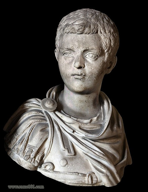 A bust of an ancient Roman child, there is some dispute over whom the statue depicts, but most scholars believe it to be Diadumenian. In this statue he is shown with a military officer's sash and soldier's dress.  Diadumenian. 2008. Photograph. Vatican, Vatican City. Flickr. Yahoo! 20 Mar. 2008. Web. 27 Sept. 2011.