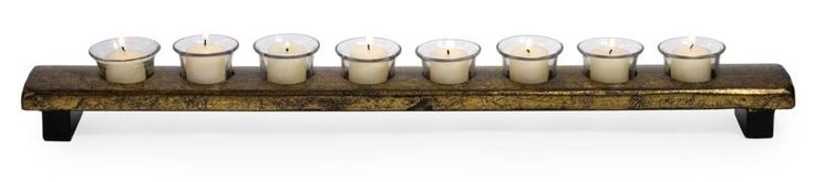 Long Gold Votive Stand, At only three and a quarter inches wide this votive holder can bring the warm glow of votive candles into the nooks and crannies of your home. This lovely centerpiece holds eight votive candles.