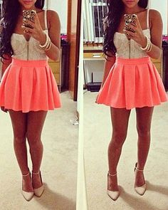 white zip up corset, pink skirt, pearl bracelets. I love everything but the shoes