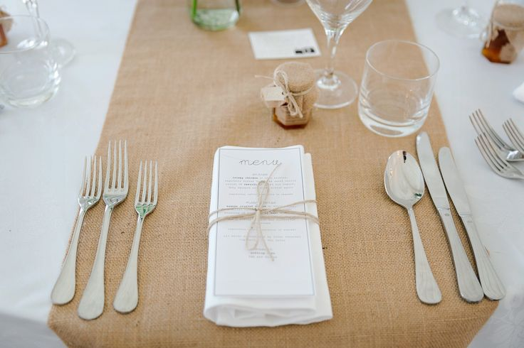 Wedding table setup. Burlap, homemade marmalade, twine tied napkins with menu.