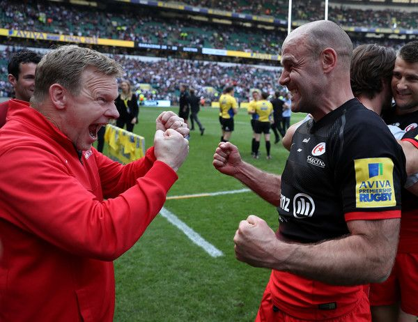 Charlie Hodgson Photos Photos - Charlie Hodgson of Saracens and Mark McCall, Saracens' Director of Rugby celebrate victory in the Aviva Premiership final match between Saracens and Exeter Chiefs at Twickenham Stadium on May 28, 2016 in London, England. - Saracens v Exeter Chiefs - Aviva Premiership Final