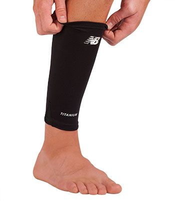 Calf/Shin Sleeve New Balance® Provides medial and lateral support and thermal warmth to the knee area. Dual stainless steel support stays provide added rigidity and support.  - Embedded with Titanium.  - Increase blood flow improving rate of recovery from fatigue and muscle strain.  - Keeps area warm while reducing muscle tension  - Enhance your ability to perform to your peak level  small  medium #12050F7 large  x-large #12050F8