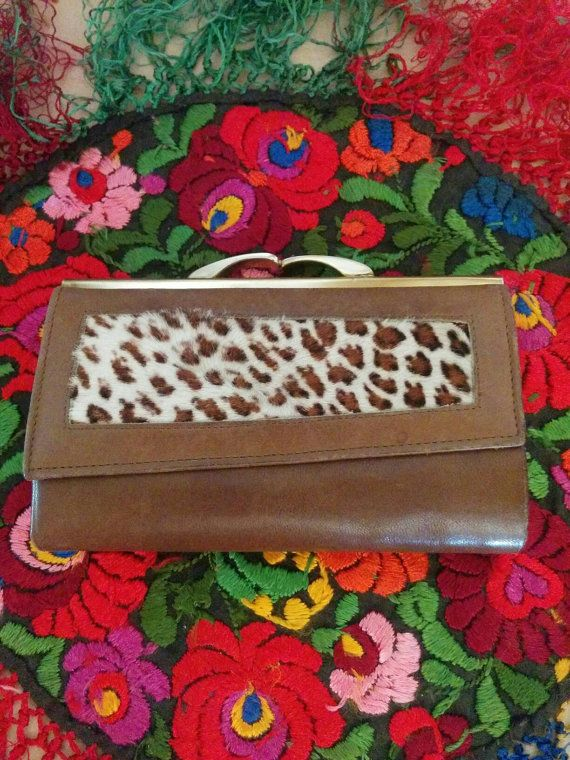 Check out this item in my Etsy shop https://www.etsy.com/listing/281203414/vintage-1970s-tan-leather-leopard-print