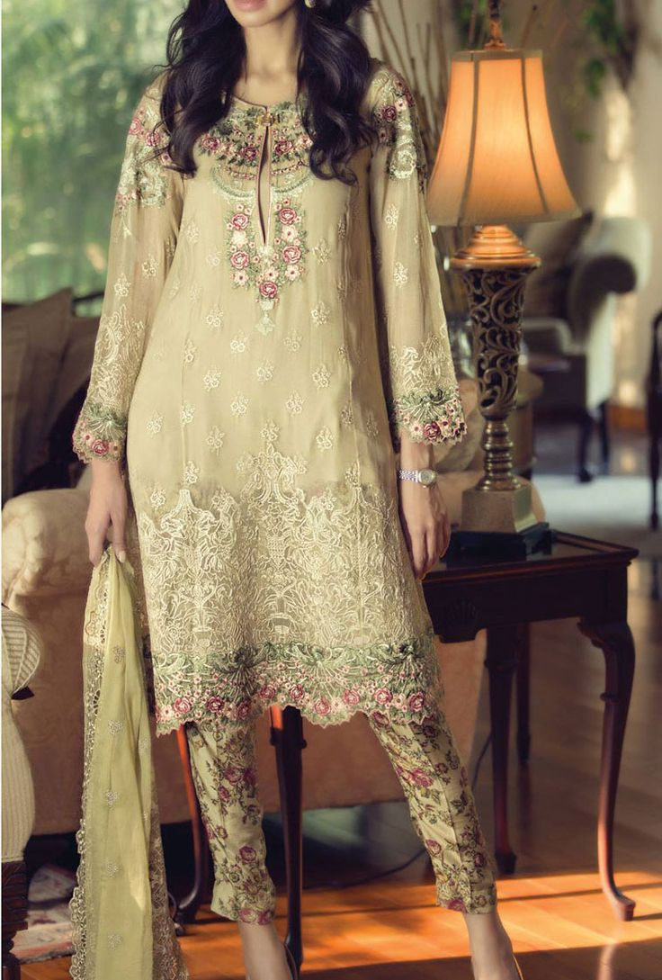 This amazing beige color embroidered winter chiffon dress by Maria B. can add colors to your fall!