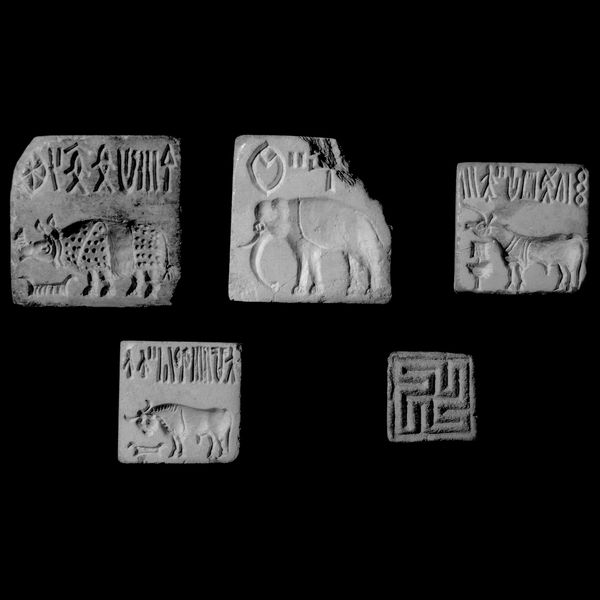 British Museum -some of the earliest evidence of the use of symbols and script in India, from the Indus Valley cities of Mohenjo-Daro and Harappa. Indus seal Harappa and Mohenjo-Daro, modern Pakistan, about 2600 to 1900 BC ...thousands of small square and rectangular seals and their impressions. These seals are useful in reconstructing the economy, art and religion of India from 2500 to 1700 BC. ...probably used in trade, as they and their impressions have been found in lands further afield.
