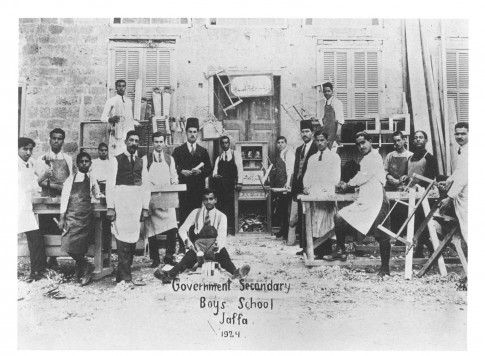 "Government Secondary Boys' School Carpentry Class | Before Their Diaspora.  Carpentry class, 1924. The inscription over the door reads, ""The least worthy of you are the least learned."""