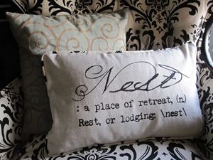 """This DIY Pottery Barn-inspired """"Nest"""" pillow was made using sewing machine embroidery. I don't have one of those, but I'm sure the same look could be achieved with fabric paint or an image transfer technique. See the tutorial."""
