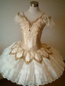 Another tutu with lots of detail. It looks more sober from a distance. The colour palette is limited to white and beige. You need to get up real close to see that the skirt is ornated all over like lace. Most tutus wouldn't bother with ornation even the first row in the theater can't see.