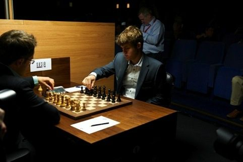 Magnus Carlsen in action at the World Chess London Candidates Tournament. Chess set by Daniel Weil.