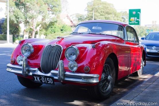 Vintage Red Jaguar on the streets of Sydney.