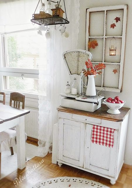 Lace curtains, farm table, sideboard, fresh apples, red & white...what's not to love???