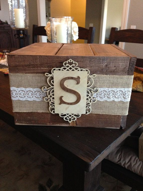 A rustic pine cake stand/box that can be used for cupcakes too. Personalize it with your own monogram. Enhanced by burlap and lace accent on Etsy, $100.00