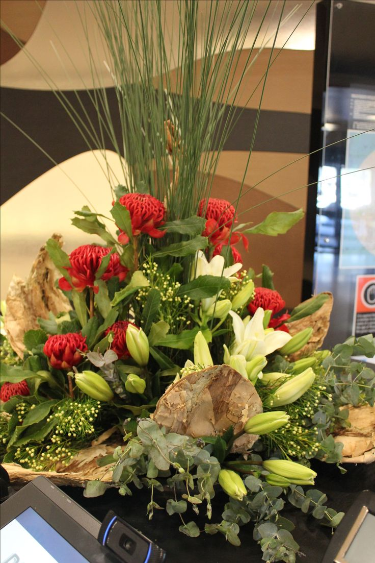 Red and White native flower arrangement waratah and lily. Created by Poppies and Peas Floral Design