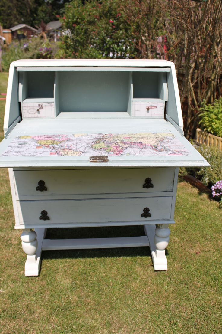 Duck Egg Map Bureau/Desk £300 – Gorgeous bureau painted in Annie Sloan duck egg base and AS old white over the top. Waxed and distressed to protect and to give a beautiful finish. Inside is duck egg with detailing in a world map. W 77cm, D 42cm, D (when open) 77cm, H 107cm www.revivedlondon.com