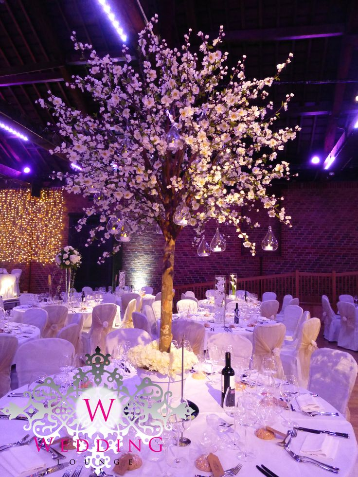 Blossom tree centrepiece with hanging glass tealights.