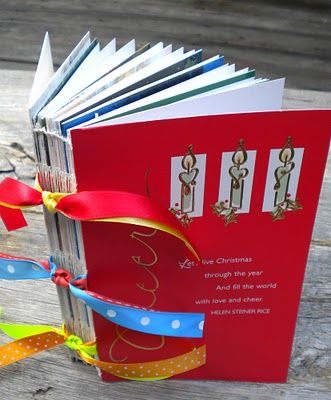 Another version of the greeting card book with stitched binding on the spine. I want to try this! My mom always wants to keep our cards and this would be a great way!