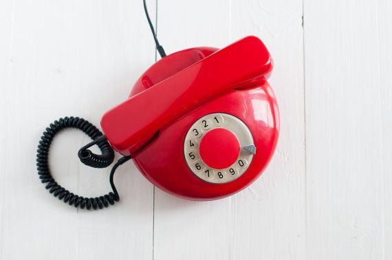 Vintage phone - Red rotary telephone made by Tesla company - 80s