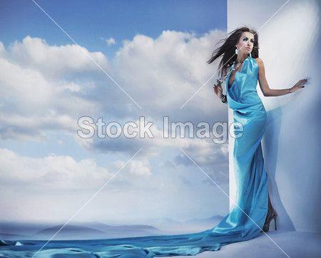 Stunning female beauty wearing blue dress
