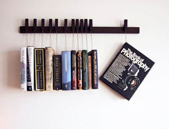 Custom made wooden book rack / bookshelf in Wenge. Pins also work as bookmarks. Bookcase on Etsy, Sold
